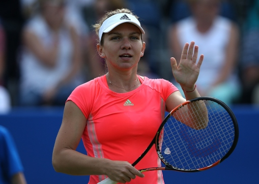 BIRMINGHAM, ENGLAND - JUNE 16:  Simona Halep of Romania celebrates victory in her match against Naomi Broady of Great Britain on day two of the Aegon Classic at Edgbaston Priory Club on June 16, 2015 in Birmingham, England.  (Photo by Jan Kruger/Getty Images for LTA)