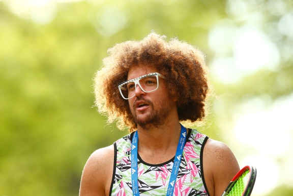 NEW HAVEN, CT: Red Foo of LMFAO demonstrates a swing during the 2015 Connecticut Open at the Yale University Tennis Center on Friday, August 21, 2015 in New Haven, Connecticut. (Photo by Jared Wickerham/Connecticut Open)