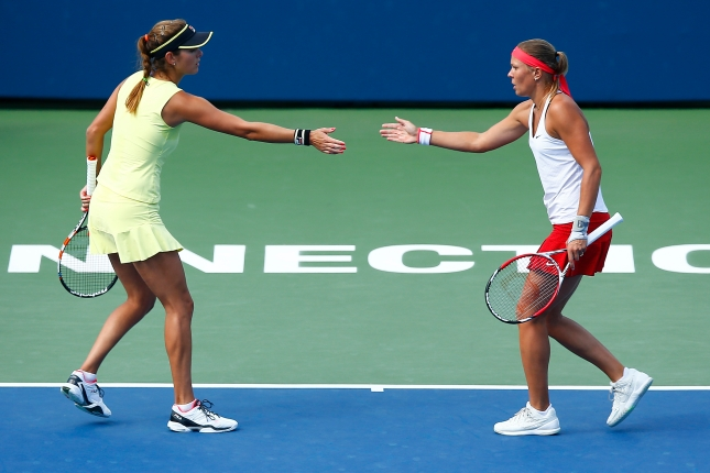 NEW HAVEN, CT: Julia Goerges and Lucie Hradecka play Raquel Kops-Jones and Abigail Spears on stadium court during the 2015 Connecticut Open at the Yale University Tennis Center on Friday, August 28, 2015 in New Haven, Connecticut. (Photo by Jared Wickerham/Connecticut Open)