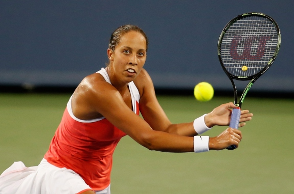CINCINNATI, OH - AUGUST 17: Madison Keys returns a shot to Timea Bacsinszky of Switzerland during Day 3 of the Western & Southern Open at the Linder Family Tennis Center on August 17, 2015 in Cincinnati, Ohio. (Photo by Rob Carr/Getty Images)