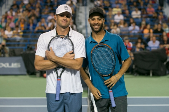 August 21, 2014, New Haven, CT: Andy Roddick and James Blake pose for a photograph at net before playing each other during the Men's Legends Event on day seven of the 2014 Connecticut Open at the Yale University Tennis Center in New Haven, Connecticut Thursday, August 21, 2014. (Photo by Billie Weiss/Connecticut Open)