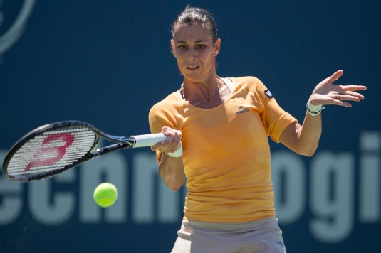 August 19, 2014, New Haven, CT: Flavia Pennetta hits a backhand during a match against Flavia Pennetta on day five of the 2014 Connecticut Open at the Yale University Tennis Center in New Haven, Connecticut Tuesday, August 19, 2014. (Photo by Billie Weiss/Connecticut Open)