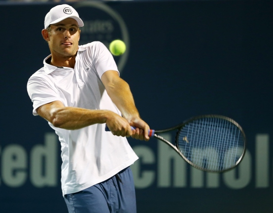 NEW HAVEN, CT - AUGUST 21: Andy Roddick returns a shot to James Blake during the Legends match during the Connecticut Open at the Connecticut Tennis Center at Yale on August 21, 2014 in New Haven, Connecticut. (Photo by Elsa/Getty Images)