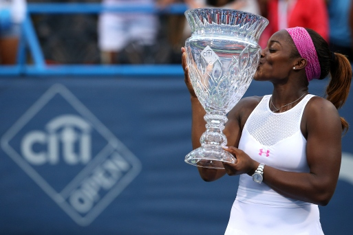 WASHINGTON, DC - AUGUST 09: Sloane Stephens of the United States kisses the trophy after defeating Anastasia Pavlyuchenkova of Russia in the women's singles final during the Citi Open at Rock Creek Park Tennis Center on August 9, 2015 in Washington, DC. (Photo by Patrick Smith/Getty Images)